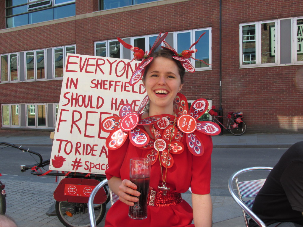 Emma Metcalfe in her #space4cycling head-dress. Celebrating after the ride with a pint of Coke. Credit - Paul Truin
